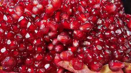 сущность : Shining juicy grains of red pomegranate bouncing on other grains