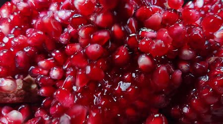essence of berries : Pomegranate juice with red ripe shiny grains is flowing down Stock Footage