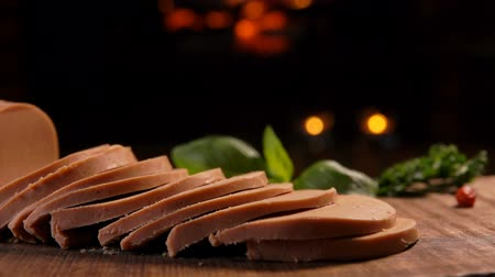 pasztet : Panorama of chopped foie gras on a wooden board on the background of a burning fireplace