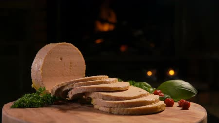 quebradiço : Panorama of sliced foie gras on a wooden board on the background of a burning fireplace
