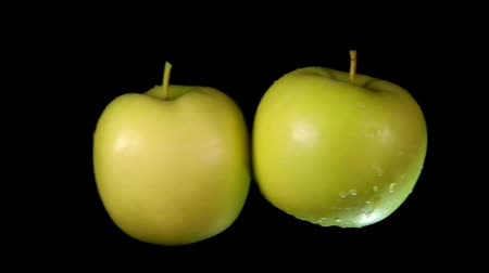 bounce : Two wet green apples collide with each other and scatter in different directions. Extreme close-up slow motion