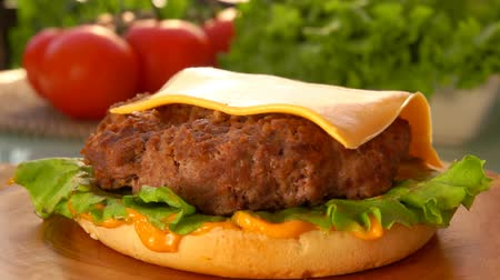 bacon burger : Cesam bun falls on the table. Prepared products for hamburgers on the table