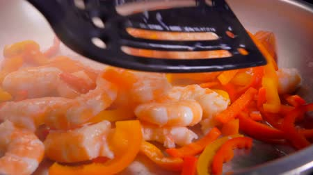 shellfish dishes : Shrimps with pepper are fried in a pan and mixed with spatula. Shrimp Recipe
