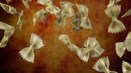 углеводы : Pasta Farfalle flying in the air on a yellow background in slow motion