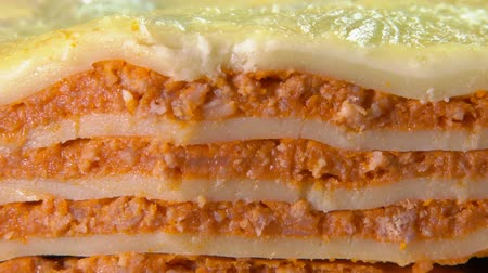 слоистых : Close-up of a piece of Italian lasagna taken out with a spatula. Lasagna with bechamel sauce, mozzarella and bolognese Стоковые видеозаписи