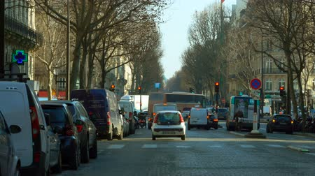 бульвар : Traffic at the European city street. Cars and bus are stopping at a crossroad on a red stop sign