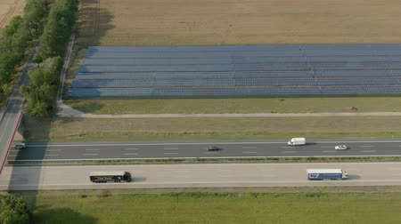 kolektor : Aerial panorama of a wide field with solar panels next to the highway. Alternative ways of energy power