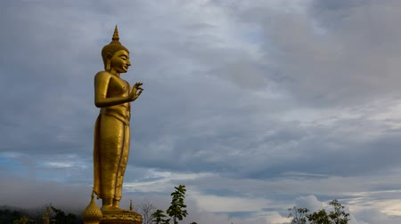 budist : Buddha statue with clouds slowly.