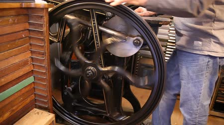 treadle : a printer operates a vintage manual letterpress