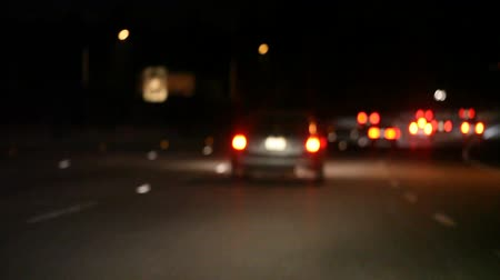 slowing : following cars braking on a California freeway at night Stock Footage