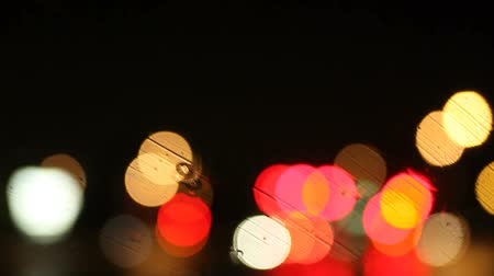 боке : colorful bokeh on a rainy night on a California freeway, rack focus