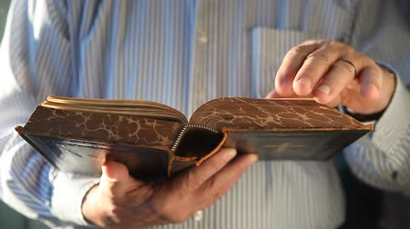 a man looks through an old German Bible