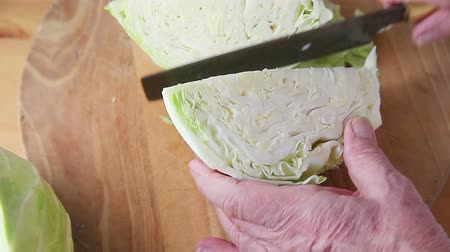 A man prepares cabbage for cooking Стоковые видеозаписи