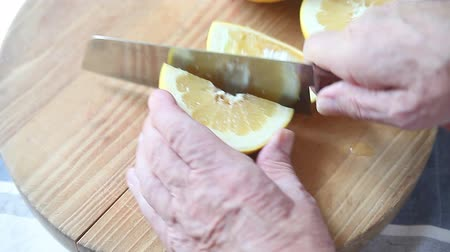 Quartering a fresh grapefruit with a sharp knife
