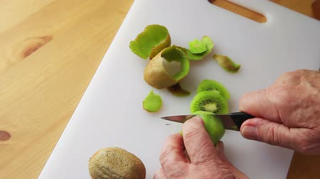 Point of view of an older man preparing fresh fruit