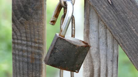 unlocking : An open old lock.