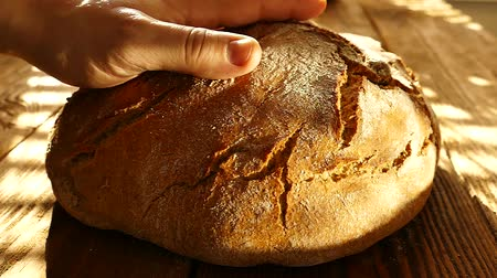 baker : Fresh bread on the table.