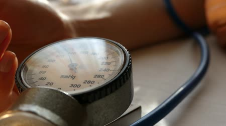 female measurements : Measurement of blood pressure. Stock Footage