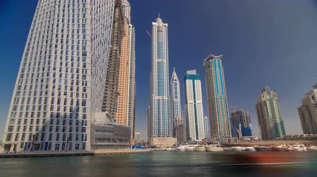 birleşik arap emirlikleri : Dubai Marina skyscrapers. View from sea embankment timelapse hyperlapse at day time Stok Video