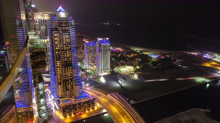 birleşik arap emirlikleri : DUBAI, UAE Dubai Marina at night view on hotels and bridge with traffic timelapse. In the city of artificial channel length of 3 kilometers along the Persian Gulf. Stok Video