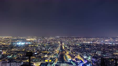 capital cities : The city skyline at night. Paris, France. Taken from the tour Montparnasse panorama timelapse traffic 4K view on railway station with trains