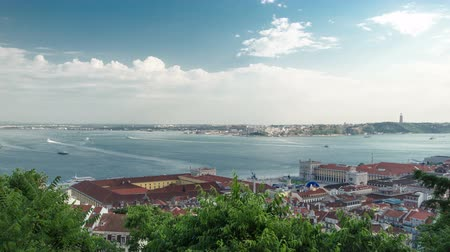 baixa : View of the historical Lisbon Baixa downtown and Tagus River, from the Sao Jorge St. George Castle in Lisbon, Portugal timelapse with ship, clouds, and trees, 4K close view