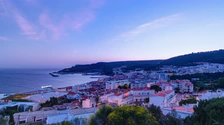 inspiradora : Twilight after sunset in Sesimbra, Portugal timelapse from day to night transition when lights turn on panorama 4K