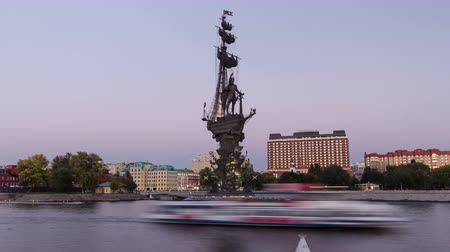komutan : Panoramic view of the monument to Russian emperor Peter the Great, on background of blue sky. Timelapse hyperlapse from day to night transition, Moscow, Russia
