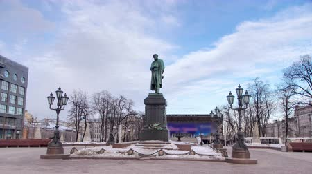 poeta : Monument to russian poet Alexander Pushkin on Pushkin Square winter timelapse hyperlapse, Moscow, Russia 4K