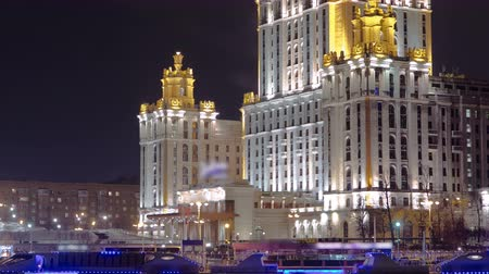 stalinist : Hotel Ukraine winter night timelapse hyperlapse - one of the seven sister skyscrapers, built in Moscow at the end of Stalins reign early 1950s. Seen with ship on Moscow River. Russia 4K