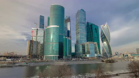 složitý : Skyscrapers International Business Center City at evening  with reflection in Moscow river before sunset timelapse hyperlapse, Moscow, Russia 4K