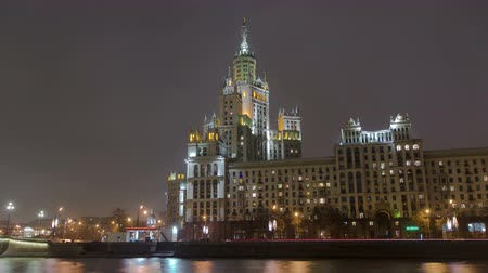stalinist : Night view of the Kotelnicheskaya Embankment Building hyperlapse, one of the Seven Sisters buildings in Moscow timelapse with reflection in Moscow river, Russia 4K Stock Footage