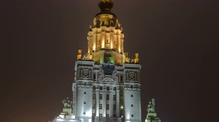 moscow night : Tower of The Main Building Of Moscow State University On Sparrow Hills At Winter timelapse hyperlapse at Night, Russia 4K