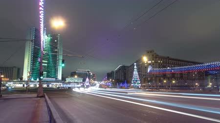 книжный магазин : Buildings at New Arbat Street winter night timelapse with car traffic. New Arbat is located in the central part of Moscow 4K