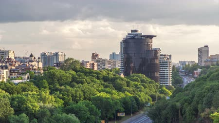 Украина : Panorama of Kiev city center timelapse hyperlapse from world war two museum with traffic and green trees with clouds, Ukraine 4K Стоковые видеозаписи