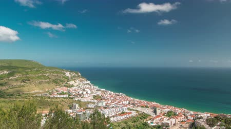 portugese : Aerial view on the coastal town of Sesimbra in Portugal timelapse with blue cloudy sky and ocean 4K Stock Footage