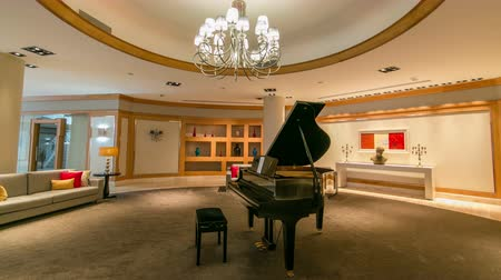 lobi : Grand piano in a luxury interior timelapse hyperlapse with sofa and chandelier