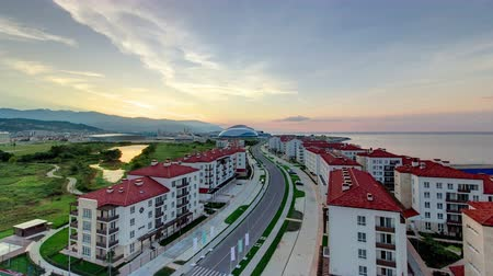paralympics : Beautiful sunrise at Olympic village and park timelapse mountains at the background. Complex of dwelling-houses in Sochi top view