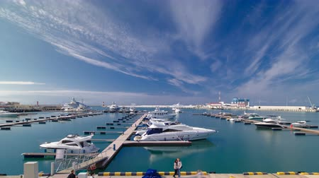 moorage : The urban cityscape timelapse hyperlapse. The citys waterfront, yacht in the sea port of Sochi 4K