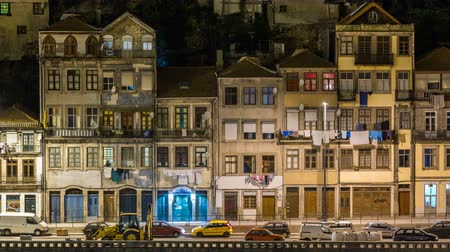 tripping : Embankment and traditional quaint houses in the old, vintage and touristic ribeira district of Porto at night timelapse, Portugal Stock Footage