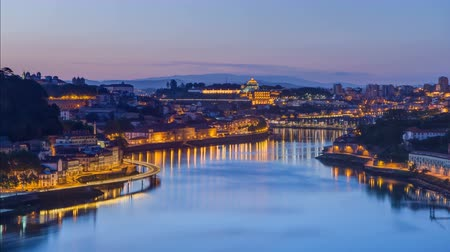 area of port : Before Sunrise at the most emblematic area of Douro river timelapse night to day transition. World famous Porto wine production area. 4K Stock Footage