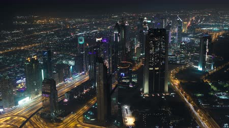 эмираты : Dubai downtown at night with city lights from Burj Khalifa timelapse, luxury new high tech town in middle East, United Arab Emirates architecture. View on sheikh zayed road 4K Стоковые видеозаписи