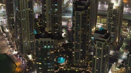 východní : Dubai downtown at night with city lights from Burj Khalifa timelapse, luxury new high tech town in middle East, United Arab Emirates architecture. View on hotels 4K Dostupné videozáznamy