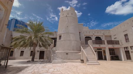 birleşik arap emirlikleri : Historic fort at the Museum of Ajman timelapse hyperlapse with blue cloudy sky, United Arab Emirates 4K Stok Video