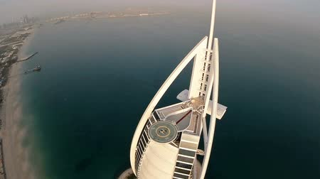 эмираты : Burj Al Arab hotel in Dubai, UAE. Helicopter view