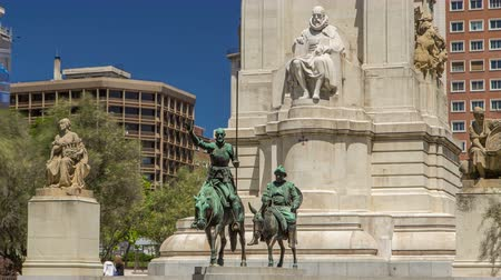 opus : View of the stone sculpture of Miguel de Cervantes timelapse hyperlapse and bronze sculptures of Don Quixote and Sancho Panza on the Square of Spain Stock Footage