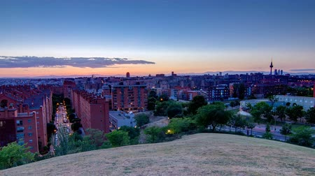 pio : Panoramic day to night timelapse View of Madrid, Spain. Photo taken from the hills of Tio Pio Park, Vallecas-Neighborhood.