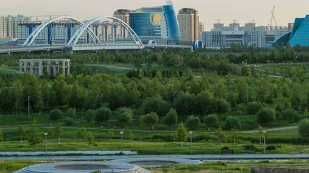 polinésia : Panorama of the Astana city before sunset timelapse with bridge and buildings. View over the park