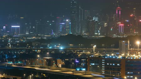 high speed road : Hong Kong Skyline near Container Terminal Night timelapse Stock Footage
