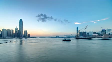 centrální čtvrť : Hong Kong, China skyline panorama with skyscrapers day to night from across Victoria Harbor timelapse.